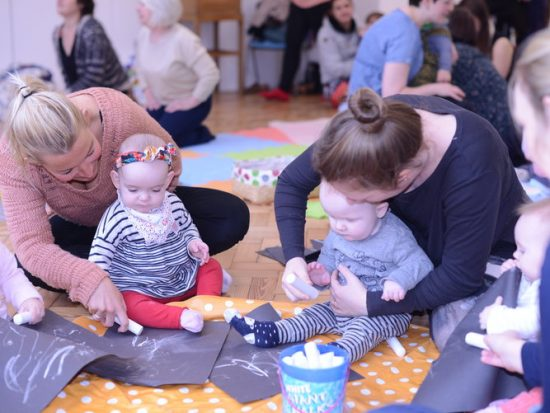 Image of babies and women taking part in an event at the Glynn Vivian Art Gallery