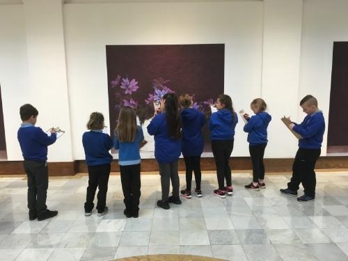 School pupils looking at an exhibit at the Glynn Vivian Art Gallery