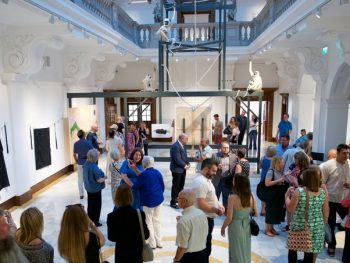 Visitors to the Glynn Vivian Art Gallery attend an exhibition in the Atrium